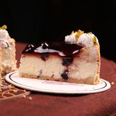 Baked Mishti Doi Cheesecake With Blueberry Compote