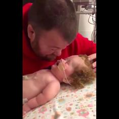 Watch this father and baby cheer each other up in Neonatal Intensive Care