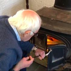 Watch: US presidential hopeful Bernie Sanders demonstrates how to light a wood-burning furnace