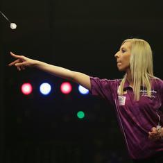 After becoming the first woman to win world darts match, Fallon Sherrock stuns with bullseye finish