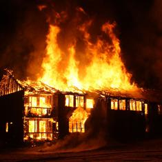 What makes a building go up in flames in this short story? How is it related to a secret illness?