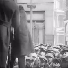 Watch this 1910 footage of illusionist Harry Houdini's iconic suspended straitjacket escape
