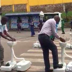 Coronavirus: Portable wash basins in Rwanda ensure bus passengers wash hands before boarding