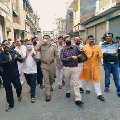 Watch: DM, police chief march with a large group on the road during 'janata curfew' in Pilbhit, UP