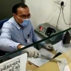 Coronavirus: Watch bank employee's optimistic sanitisation routine with an electric iron