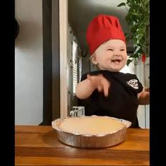 Watch: This child's messy but adorable pizza-making skills are melting hearts