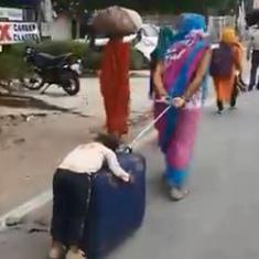 Man pulls pregnant wife on handmade wooden cart, child sleeps on suitcase: Scenes from a migration