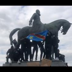 Watch: Brussels protestors chant 'murderer' and 'reparations' at a statue of colonial king