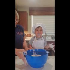 Watch: Two-year-old 'chef' eats raw cookie ingredients, including eggs, while baking with grandma