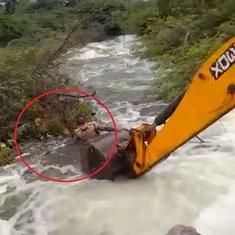 Watch: Home guard rescues dog from edge of rushing torrent with the help of construction equipment