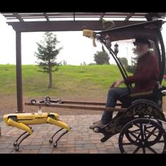 Watch: Robot dog Spot effortlessly pulls a rickshaw with designer Adam Savage on it