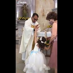 Watch: Priest raises his hand to bless little girl, she gives him a high-five