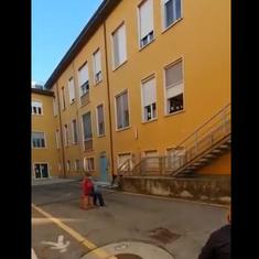 Watch: 81-year-old Italian man plays the accordion for wife in hospital while sitting in the street