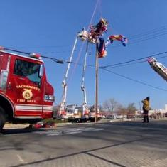 Watch: Paragliding Santa Claus rescued after getting entangled in power lines