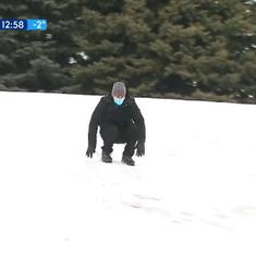 Watch: Weather reporter continues his forecast while sliding downhill on snow