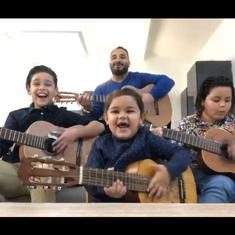 Watch: Family of four, three of them children, joins in to play the guitar and sing together