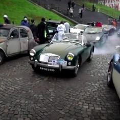 Watch: Hundreds of vintage cars drive through the streets of Paris