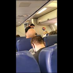 Watch: Aircraft crew cheer and dance, passengers applaud, as anti-mask couple is escorted out