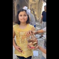Watch: Two Gaza children are happy they saved their pet fish after Israeli bomb destroyed their home