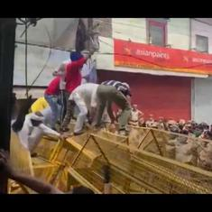 Watch: Farm law protestors jump over police barricades and bump them with a tractor in Haryana