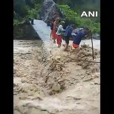 Watch: People cross river on half-destroyed bridge as torrents rage over it in Uttarakhand