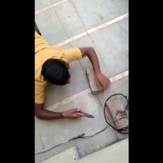 Watch: Man crawls out to balcony to illegally snip power cable, realises he is being filmed