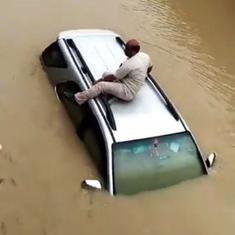 Watch: Man climbs on car roof to save himself from drowning in flooded street in Baghpat, UP
