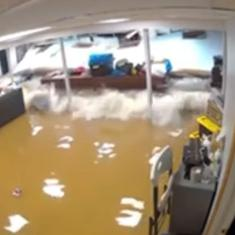 Caught on CCTV: The moment a basement wall collapsed from floodwater in New Jersey