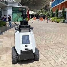 Watch: Robot tells off man for smoking on covered walkway in Singapore