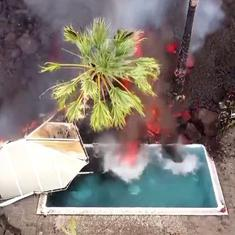 Watch: Burning lava from volcano engulfs  swimming pool and entire houses in Spain's La Palma